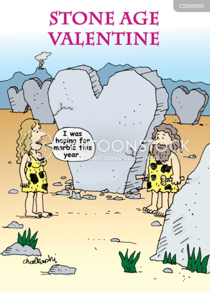 a cave-woman is looking at her husband and the huge heart shape stone he has chiseled. She is disappointed it's not in marble this year. You can see past heart-shaped sculptures in background.