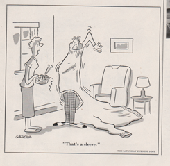"Cartoon by Gallagher showing a woman and man. The man is trying on a huge sweeter and the woman is saying ""that's a sleeve."""