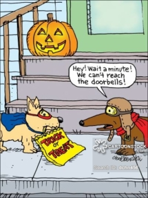 Two dogs out trick or treating realize they can't reach the doorbell.